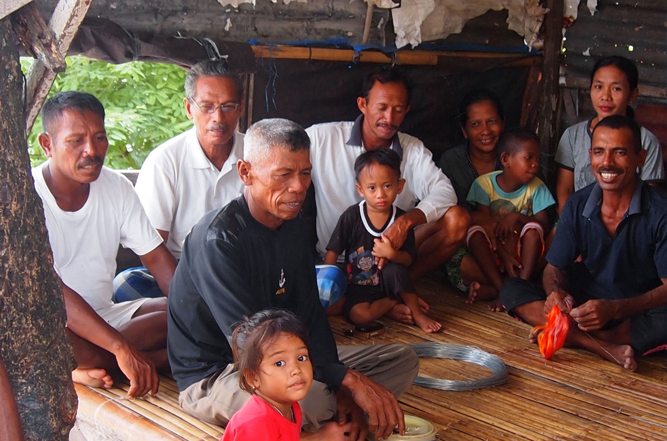 A group of fishermen and their families on the island of Tomia, in Sulawesi.