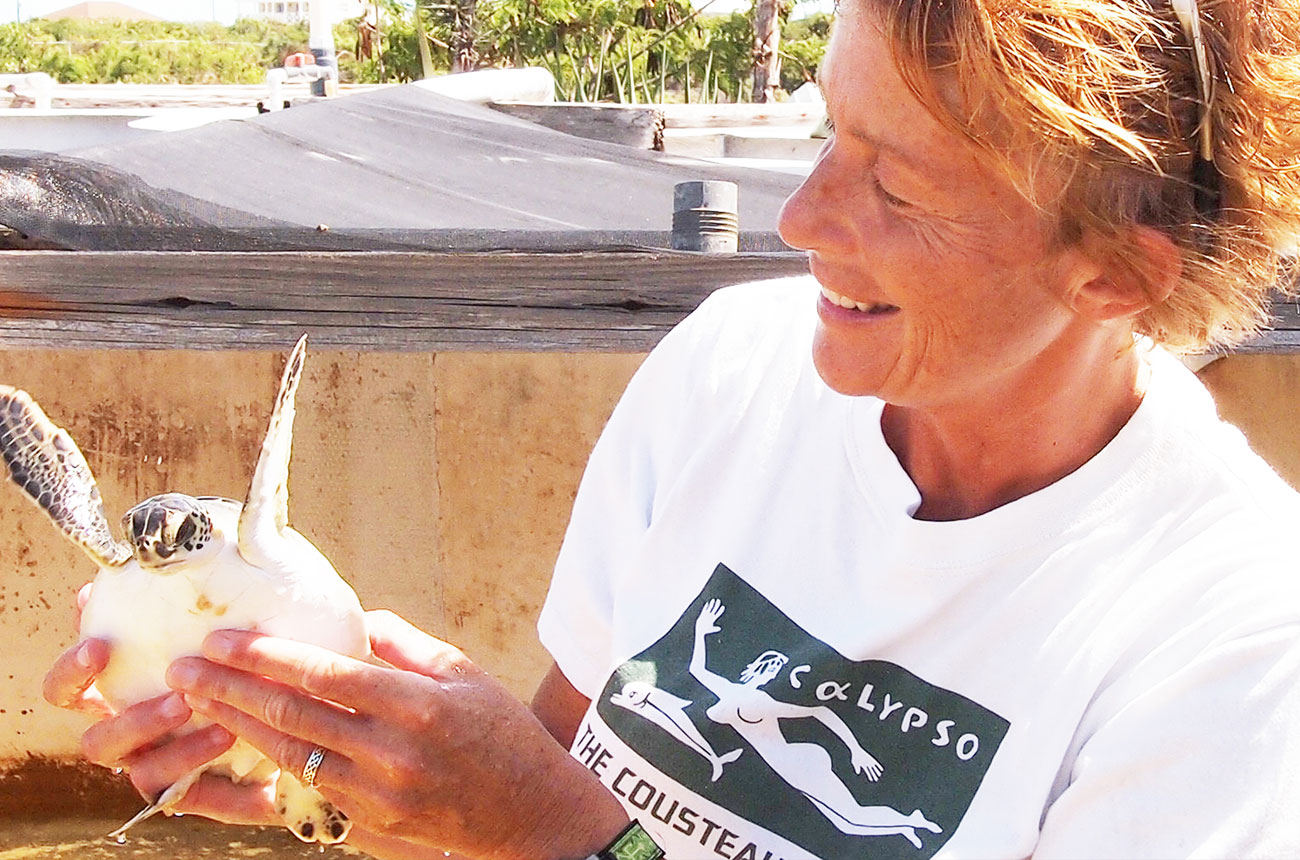 Cunningham with a rescued sea turtle in the Turks and Caicos Islands.