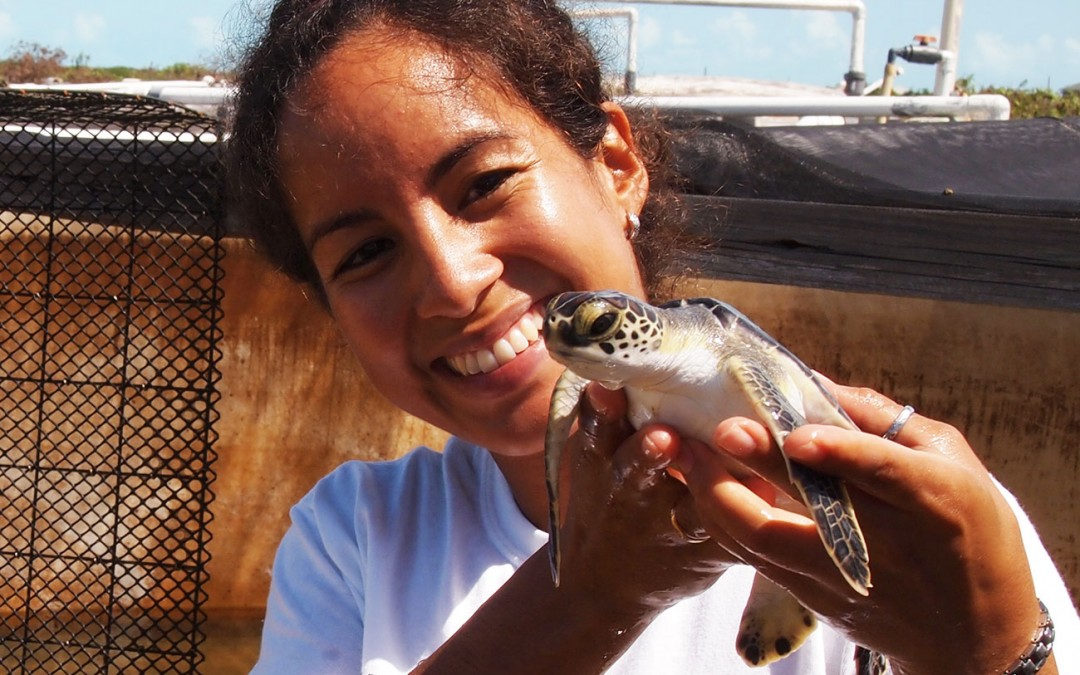 Eiglys Trejo holding one of 9 sea turtles she cared for and then released.